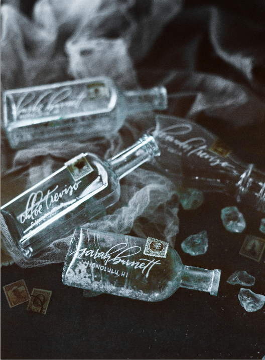 Placecard bottles with calligraphed names