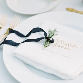 Placecard in gold galligraphy with rosemary and ribbon | Taryn Eklund Ink | Ashley Sawtelle Photography