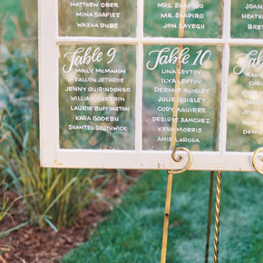 Seating chart on a vintage window | Taryn Eklund Ink | Ashley Sawtelle Photography
