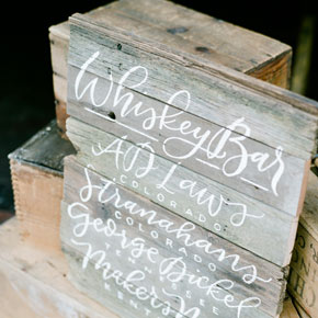 hand painted whiskey bar menu on reclaimed wood | Taryn Eklund Ink | photo by Connie Whitlock Photography